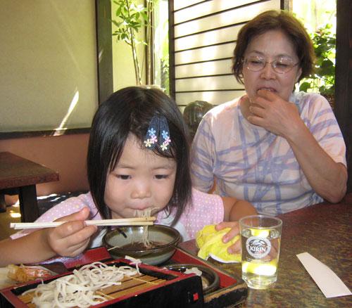 Little girl eating soba