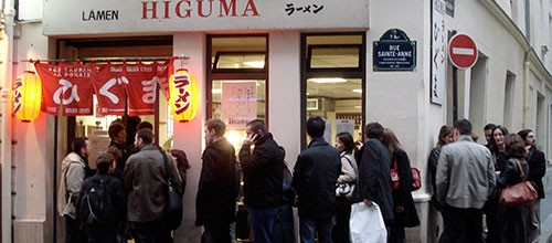 IMG: Lining up for ramen (lamen) in Paris.